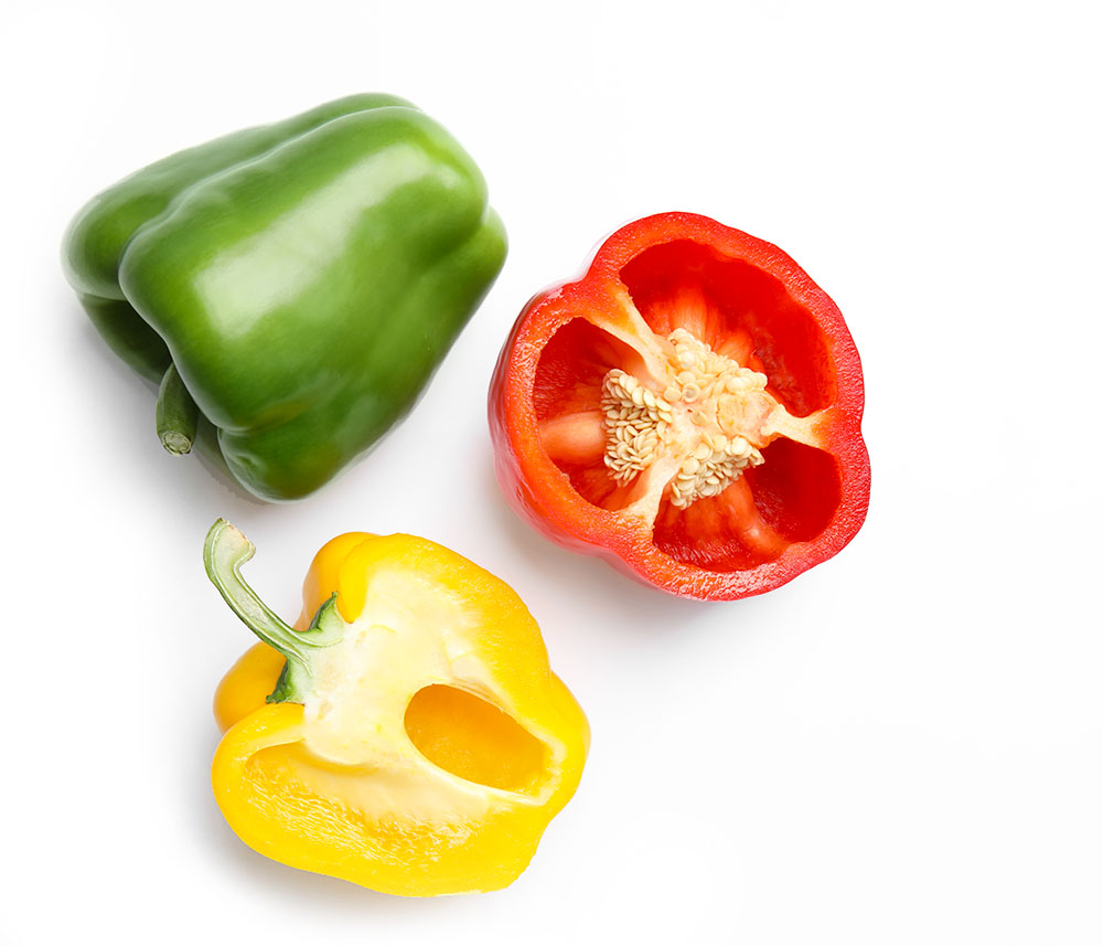 Retail Learning Green, Red, and Yellow Bellpeppers on a white background